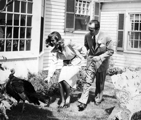 Turkey Day Greeting: Bogie and Bacall chat up a turkey
