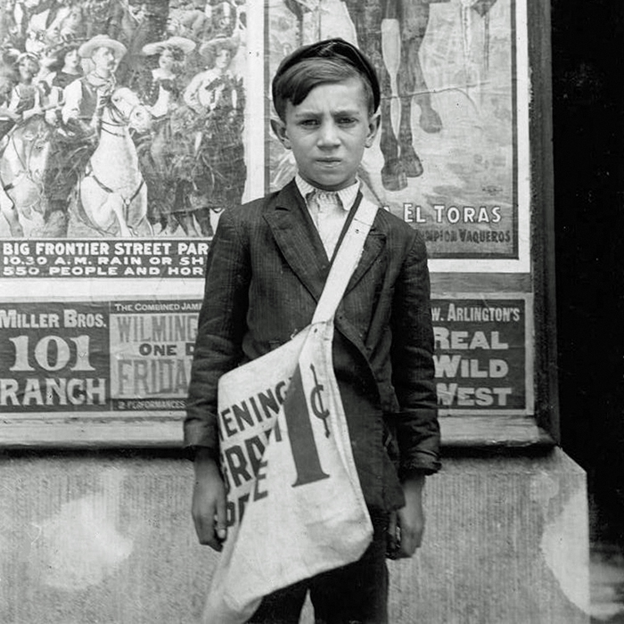 a 1915 photograph of a young newsboy announcing Cladrite Radio App