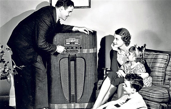 A family happily tunes into Cladrite Radio